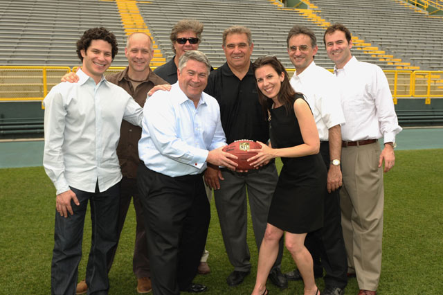 Back row, from left: Tommy Kail, David Maraniss, Eric Simonson, Dan Lauria, TK, TK. Front row: Tony Ponturo and Fran Kirmser at Lambeau Field.