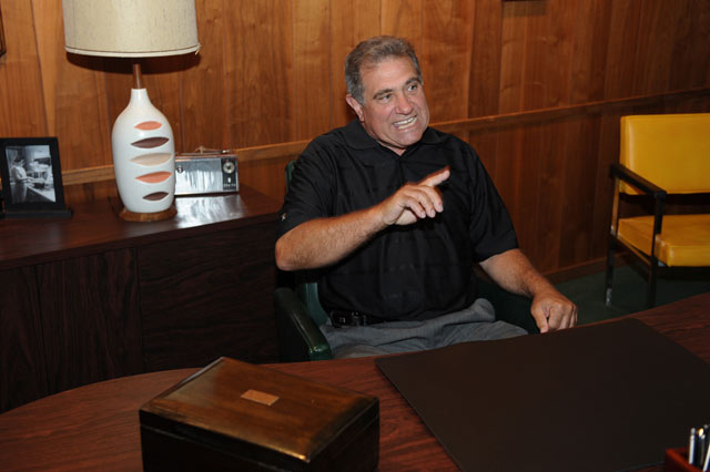 Dan Lauria at Lombardi's desk in the Lambeau Field Hall of Fame.